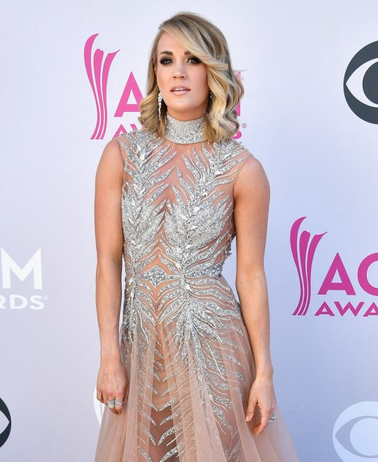 Carrie Underwood wore Harry Kotlar diamond earrings, a Hearts on Fire diamond band and a Djula diamond ring