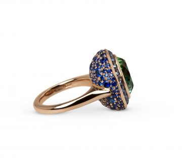 Flowerbud Ring: 8.64ct green tourmaline with blue sapphires in 18ct rose gold.