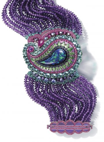 Chopard cuff composed of amethyst beads and set with topaz, rubies, tanzanites, purple sapphires, red and pink spinels, Paraiba tourmalines and a black opal