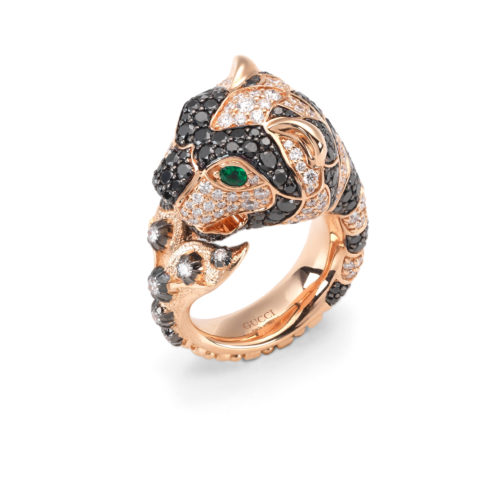 5. Gucci Tiger ring in gold with black and whit diamonds and emeralds