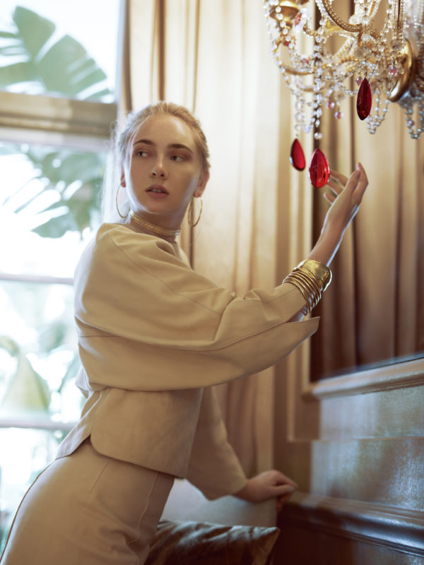 Suede top and shorts by Hermés; gold choker by Noor Fares; gold earrings by Dinny Hall.  Bracelets (left to right): Gold multi-hoop bracelet by Dinny Hall; gold bracelet and gold cuff by Pippa Small.