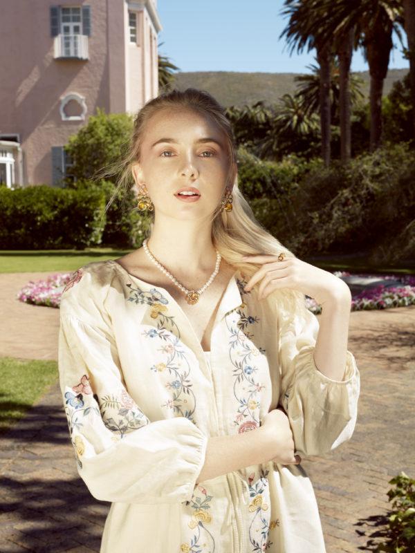 Dress by Vilshenko; Bee earrings, ring and necklace, all by Delfina Delettrez.