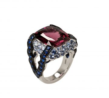 A 13.65ct garnet with blue sapphires in 18ct white and black gold.