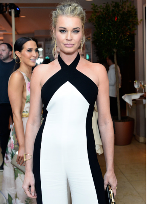Rebecca Romijn wore a pair of Djula diamond earrings and cuff