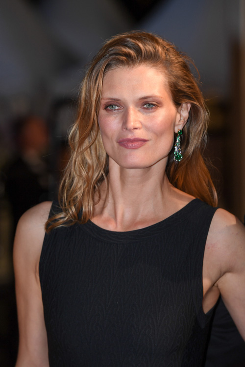 Malgosia Bela wore earrings from Chaumet est une fête collection to accompany her Film Director husband at the Premiere of his film at the Cannes Film Festival.  Earrings in white gold, yellow gold and lacquer, set with two cushion-cut emeralds  from Colombia Muzo, two cabochon-cut emeralds from Zambia, round rubies and emeralds, baguette-cut sapphires and yellow sapphires, and brilliant-cut diamonds