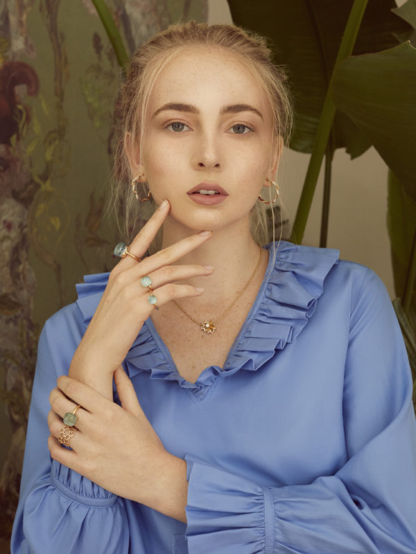 Shirt by Stella McCartney; Diorama earrings by Dior Jewellery; Archi necklace by Dior Jewellery; blue gemstone rings by Pomellato; Archi ring by Dior Jewellery