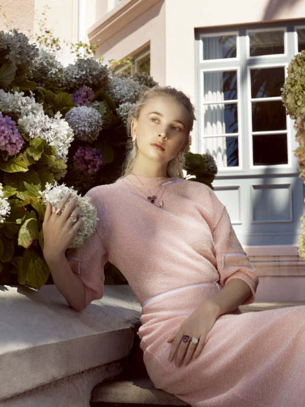 Dress by Christopher Kane; pink butterfly necklace, earrings and ring, all by Stephen Webster; red necklace and ring by Annoushka; moonstone rings by Noor Fares.